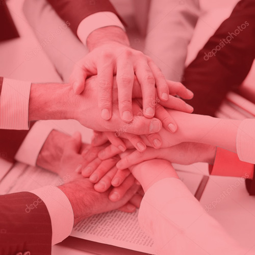 Hands joined together in team environment